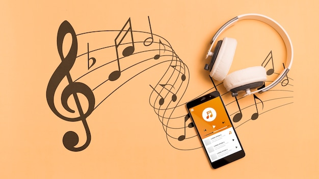 Top view of smartphone with headphones and musical notes Premium Psd