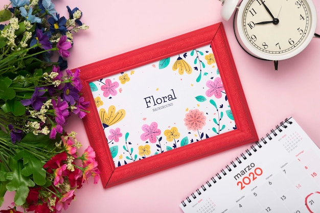 Top view of spring flower with calendar and frame Free Psd