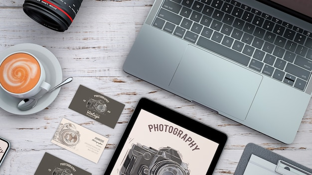Top view stationery mockup with photography concept Free Psd