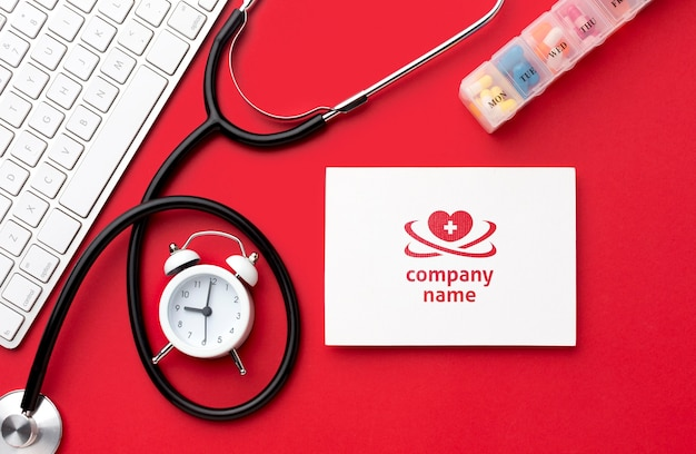 Top view stethoscope on red background Free Psd