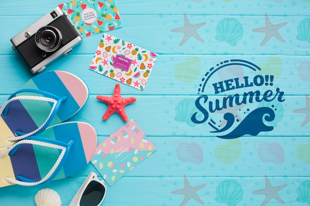 Top view summer flip flops with camera on the table Free Psd
