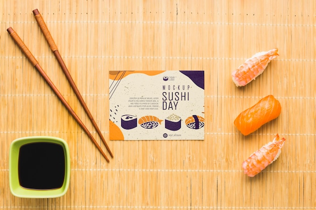Top view of sushi with chopsticks and soy sauce Free Psd