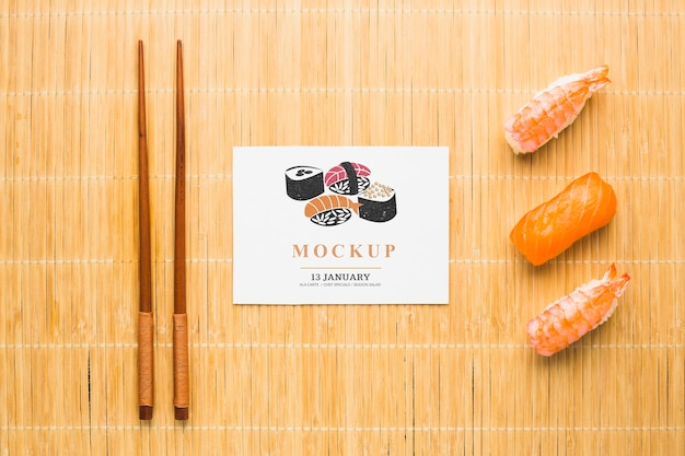 Top view of sushi with chopsticks Free Psd