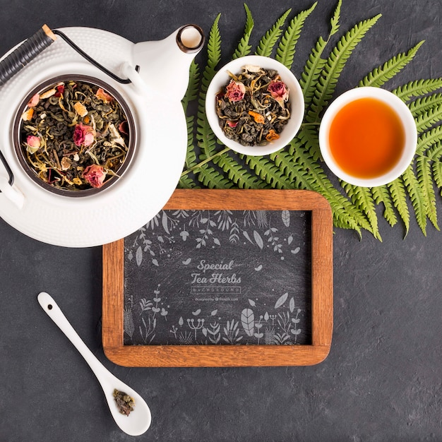 Top view tea pot with menu and herbs Free Psd