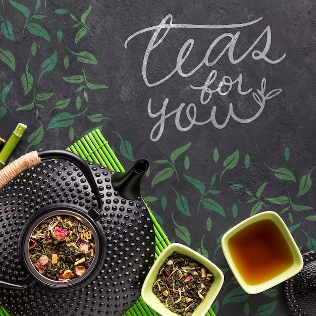 Top view tea pot with tasty herbs concept Free Psd