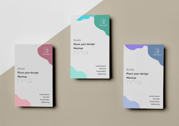 Top view of three business cards with braille design Free Psd