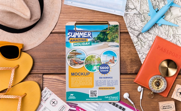 Top view travel mock-up clipboard and beach equipment Free Psd