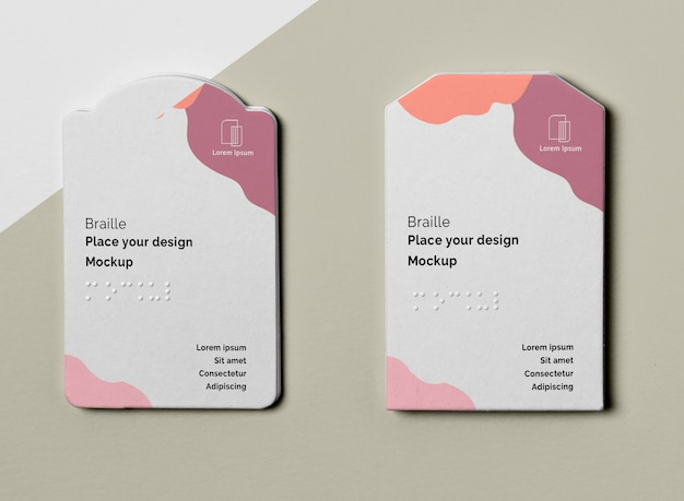 Top view of two business cards with braille Free Psd