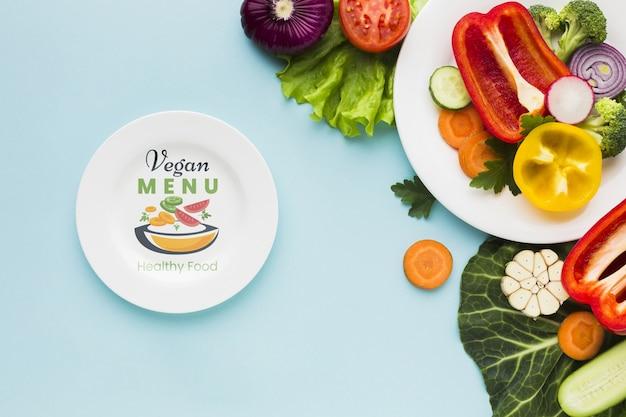 Top view vegan menu with organic vegetables Free Psd