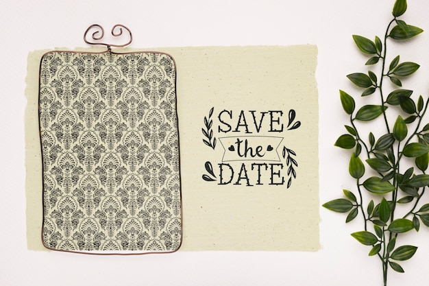 Top view vintage frame and plant save the date mock-up Free Psd
