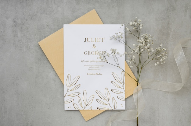 Top view of wedding card with flowers and ribbon Free Psd