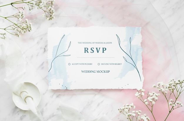 Top view of wedding card with flowers and rings Free Psd