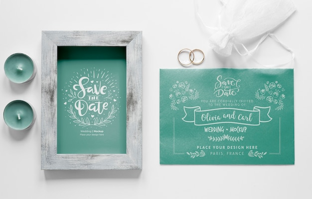 Top view of wedding card with frame and candles Free Psd
