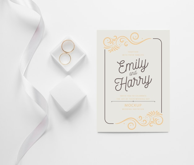 Top view of wedding card with ribbon and rings Free Psd