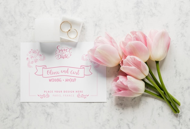 Top view of wedding card with tulips and rings Free Psd