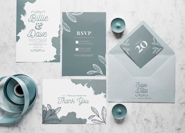 Top view of wedding cards with envelope and candles Free Psd