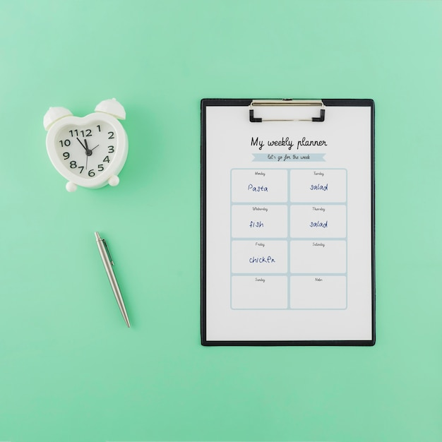Top view weekly planner with mock-up Free Psd