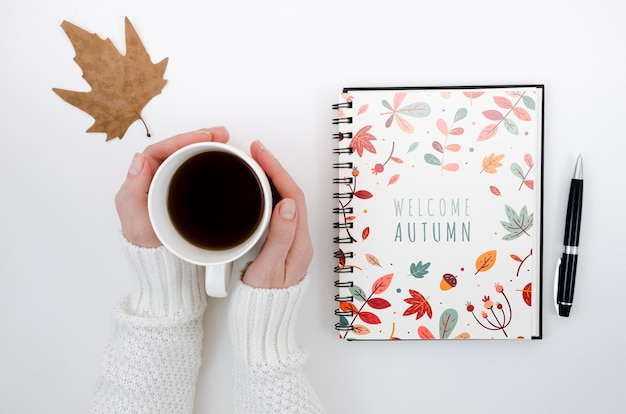 Top view welcome autumn on notebook Free Psd