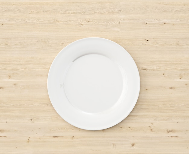 Top view white plate on wooden table Free Psd