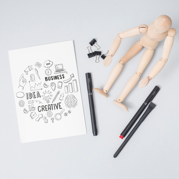 Top view wooden doll with pens Free Psd