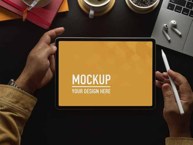 Top view of workspace with digital tablet mockup Premium Psd