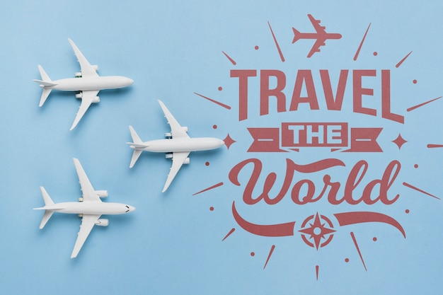 Travel the world, inspirational lettering quote with airplane toys Free Psd