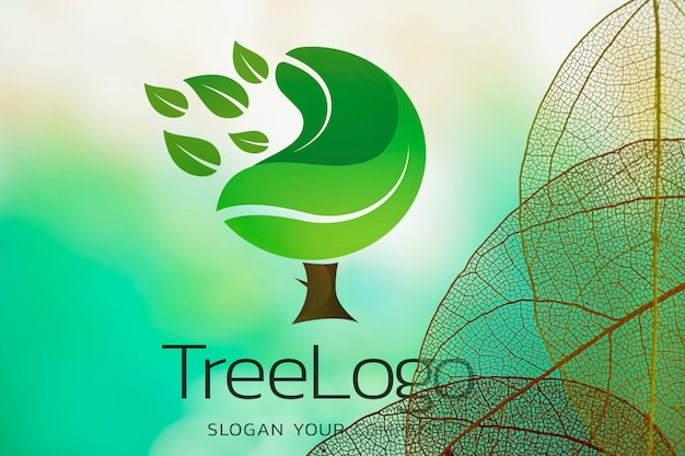 Tree logo with translucent leaves Free Psd