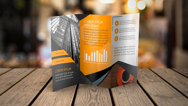 Trifold brochure mockup on tabletop Free Psd