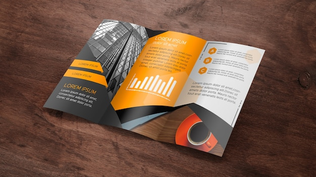 Trifold brochure mockup on wooden surface Free Psd