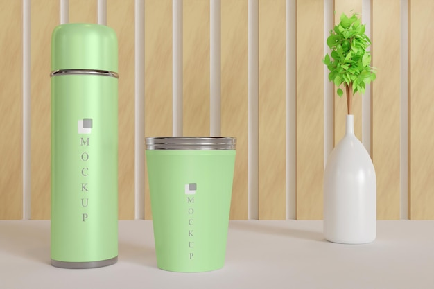 Tumbler and drink cup mockup with plant vase Premium Psd