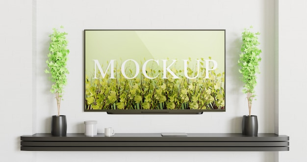 Tv mockup mounted on the white wall with black wall desk Premium Psd