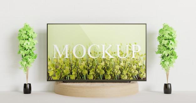 Tv mockup on the wooden podium between couple decoration plants Premium Psd