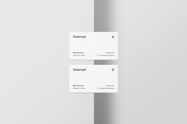 Two business cards half table Free Psd