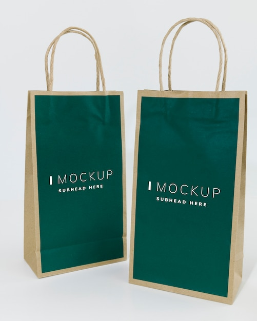 Two green paper bag mockups Free Psd