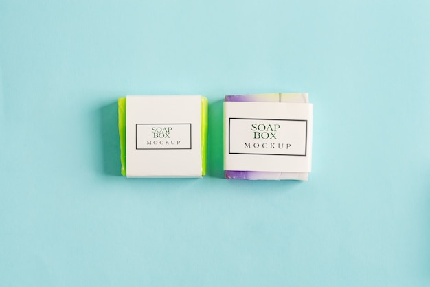 Two handmade soap wrap box mock-up package with colorful bar soap isolated on blue background Premium Psd