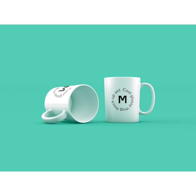Two mugs on green background mock up Free Psd
