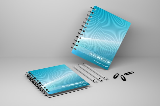 Of two office spiral notebooks sketchbooks, three carbon pencils and paper pins Premium Psd
