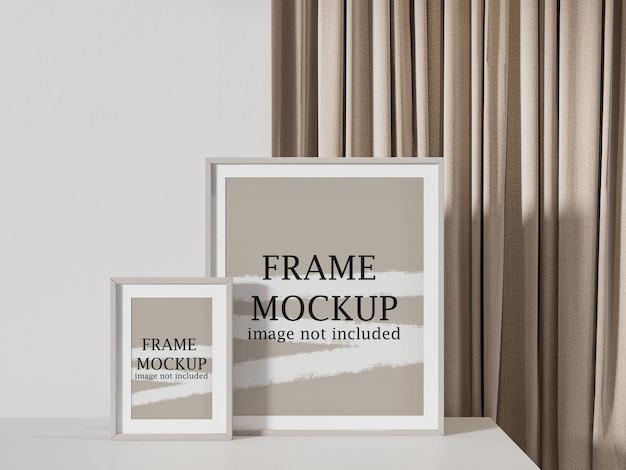 Макет двух рамок для картин перед занавеской Premium Psd
