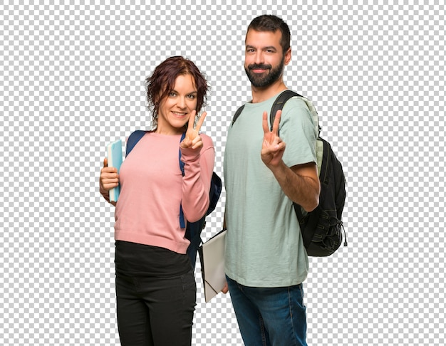 Two students with backpacks and books happy and counting two with fingers Premium Psd