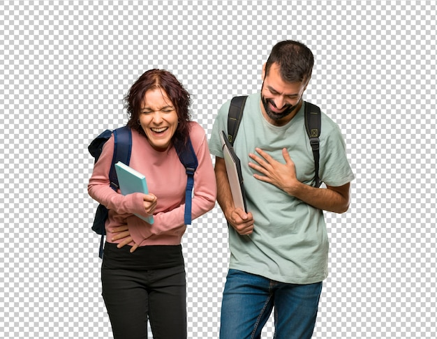 Two students with backpacks and books smiling a lot while putting hands on chest Premium Psd