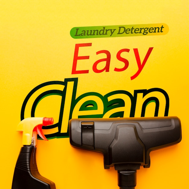 Vacuum cleaner next to spray bottle Free Psd