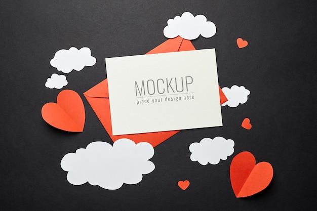 검은 색 표면에 종이 장식으로 발렌타인 데이 카드 모형 프리미엄 PSD 파일