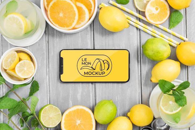 Various lemons and mock-up mobile phone Free Psd