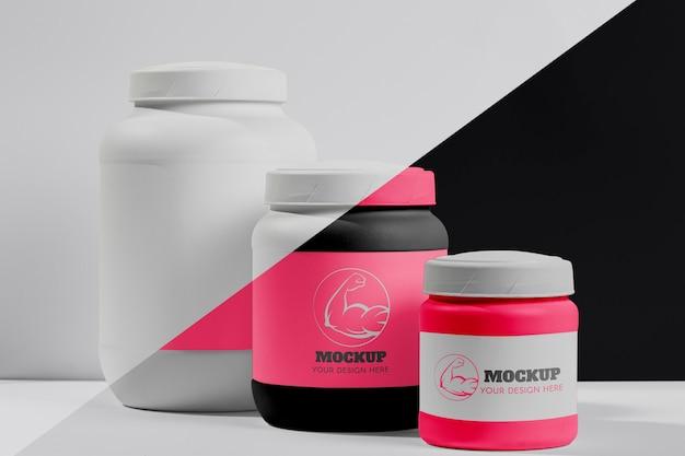Varie polvere e pillole rosa della proteina di forma fisica Psd Gratuite
