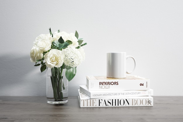Vase with flowers, mug and stacked books Free Psd