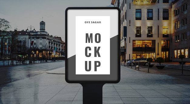 Vertical billboard mockup at bus stop on the night city PSD