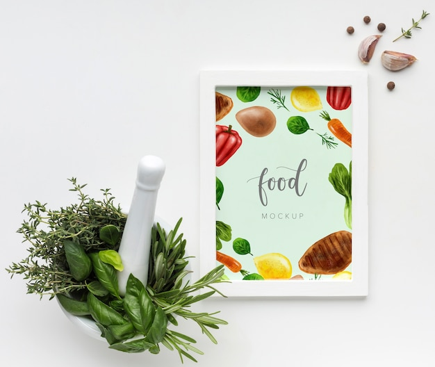 Vertical food mock-up frame with garlic and herbs Free Psd
