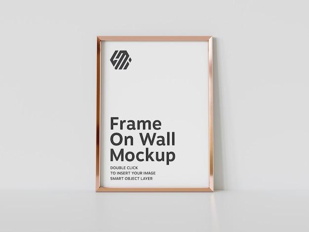 Vertical golden frame leaning on floor mockup Premium Psd