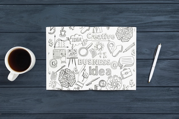 Above view arrangement with notebook on wooden background Free Psd