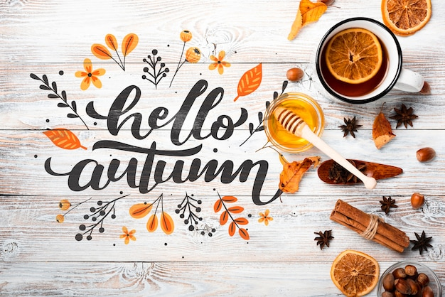Above view autumn arrangement on wooden background Free Psd
